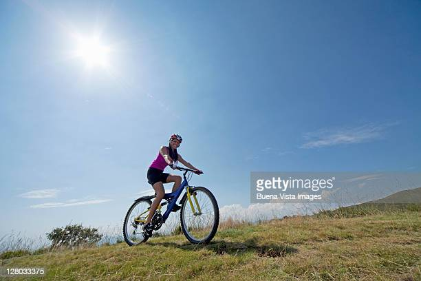 Young woman with mountain bike