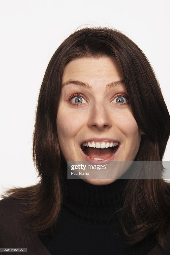 Young woman with mouth open, portrait, close-up : Stock Photo