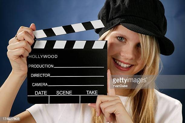 young woman with movie action clapboard