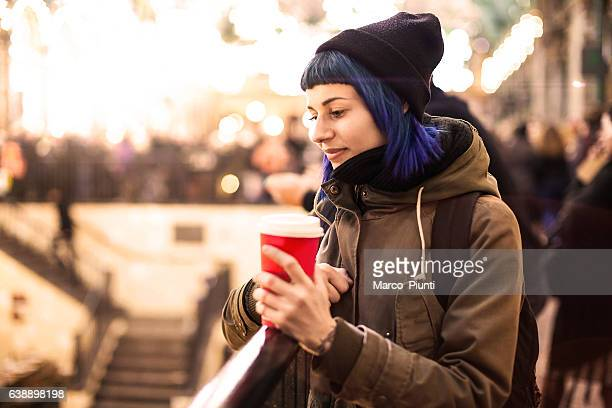 Young woman with mug in the city