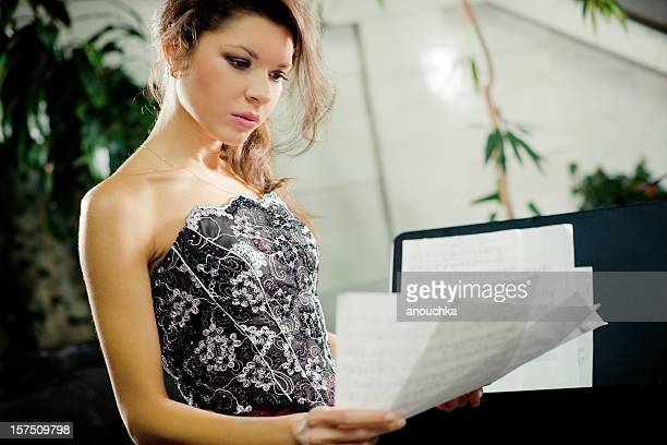 Young Woman with Music Sheet