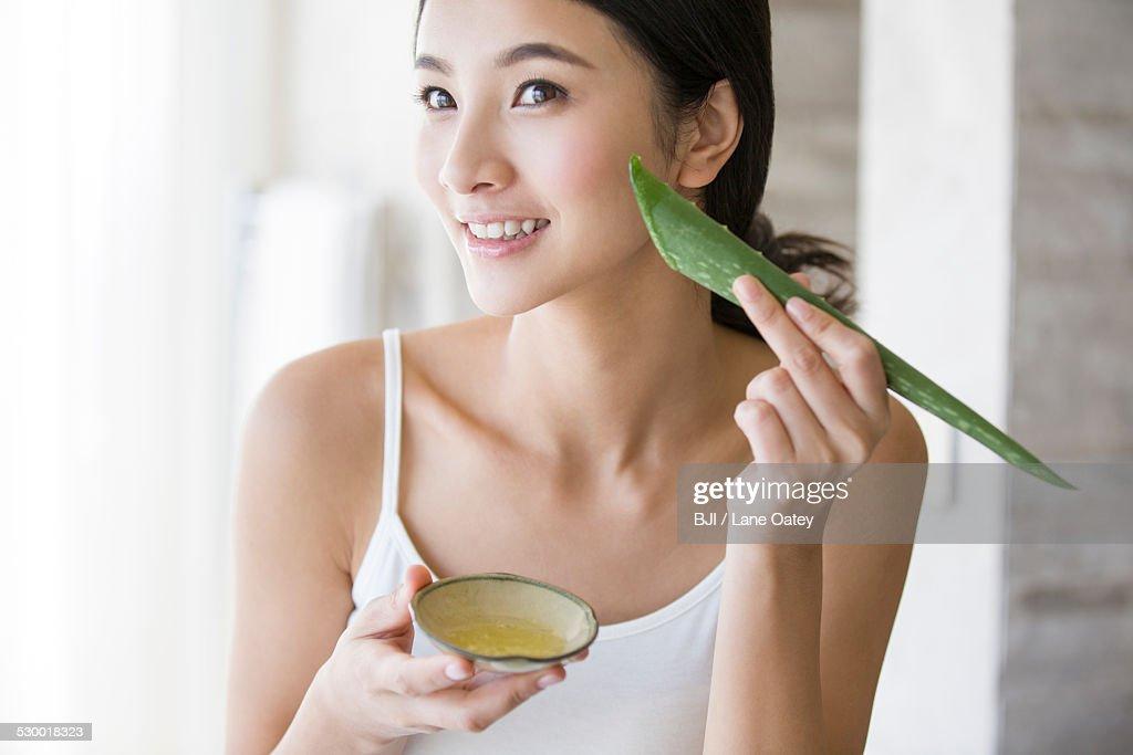 Young woman with natural aloe vera