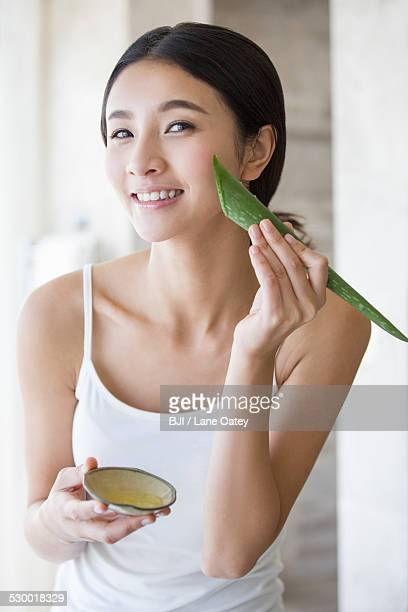 Young woman with natural aloe vera