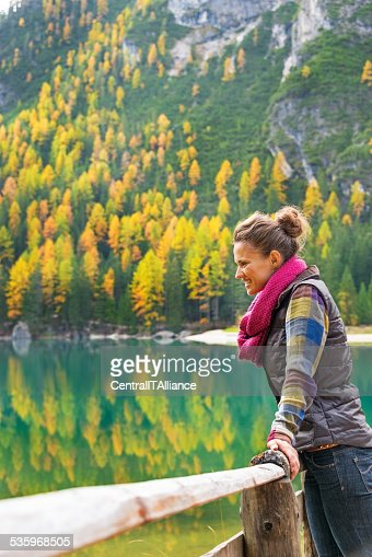 Young woman with on lake braies in south tyrol, italy : Stock Photo
