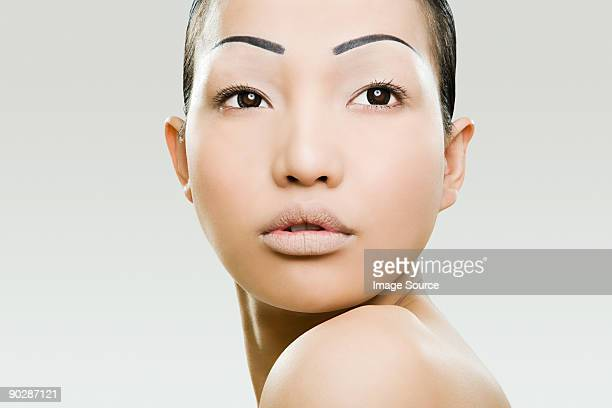 Young woman with painter eyebrows