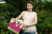 Young woman with Pekinese dog