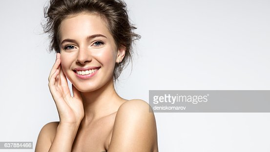 Young woman with perfect skin clean and white teeth : ストックフォト