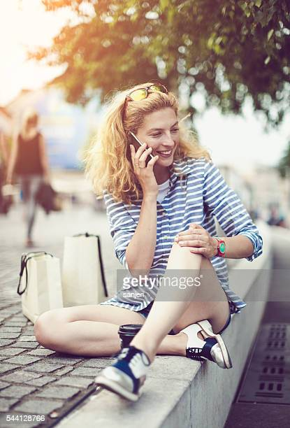 Young woman with phone on the street