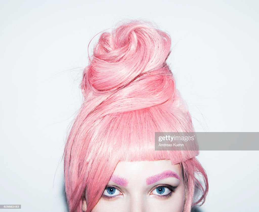 Young woman with pink hair wig in an updo, crop. : Stock Photo