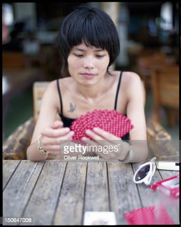 Young woman with poker cards : Stock Photo