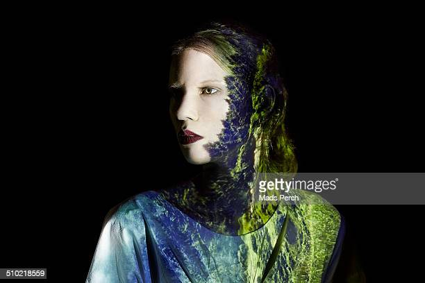 Young Woman with Projection of Landscape