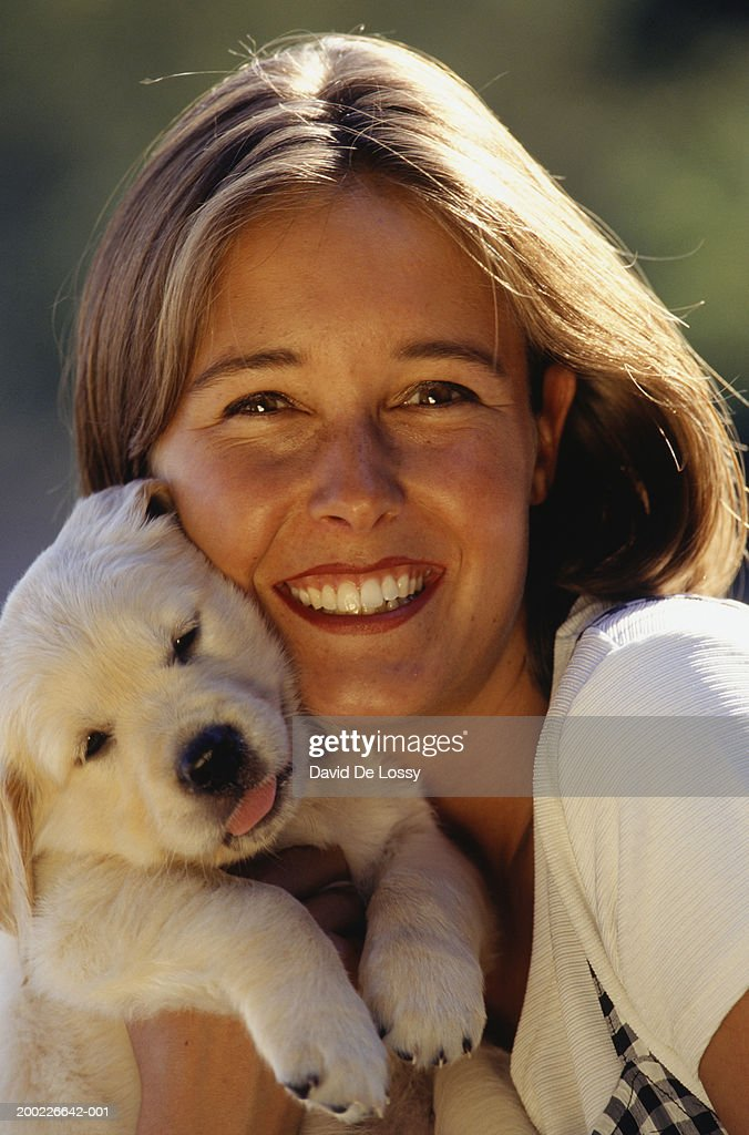 Young woman with puppy, portrait : Stock Photo