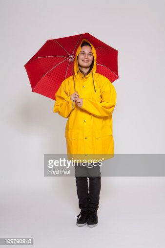 Young woman with raincoat and umbrella