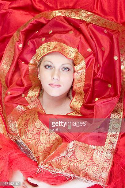Young woman with red and gold silks