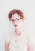 Young Woman with Red Hair and Gold Glasses