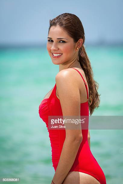 Young woman with red swimsuit on beach