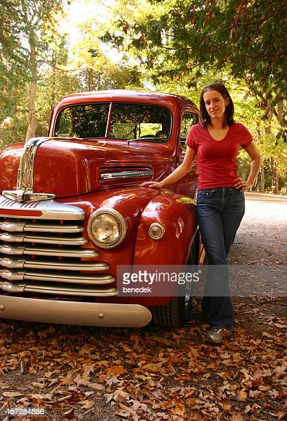 Young Woman with Red Vintage Pick-up Truck