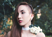 Young beautiful woman close up portrait in nature
