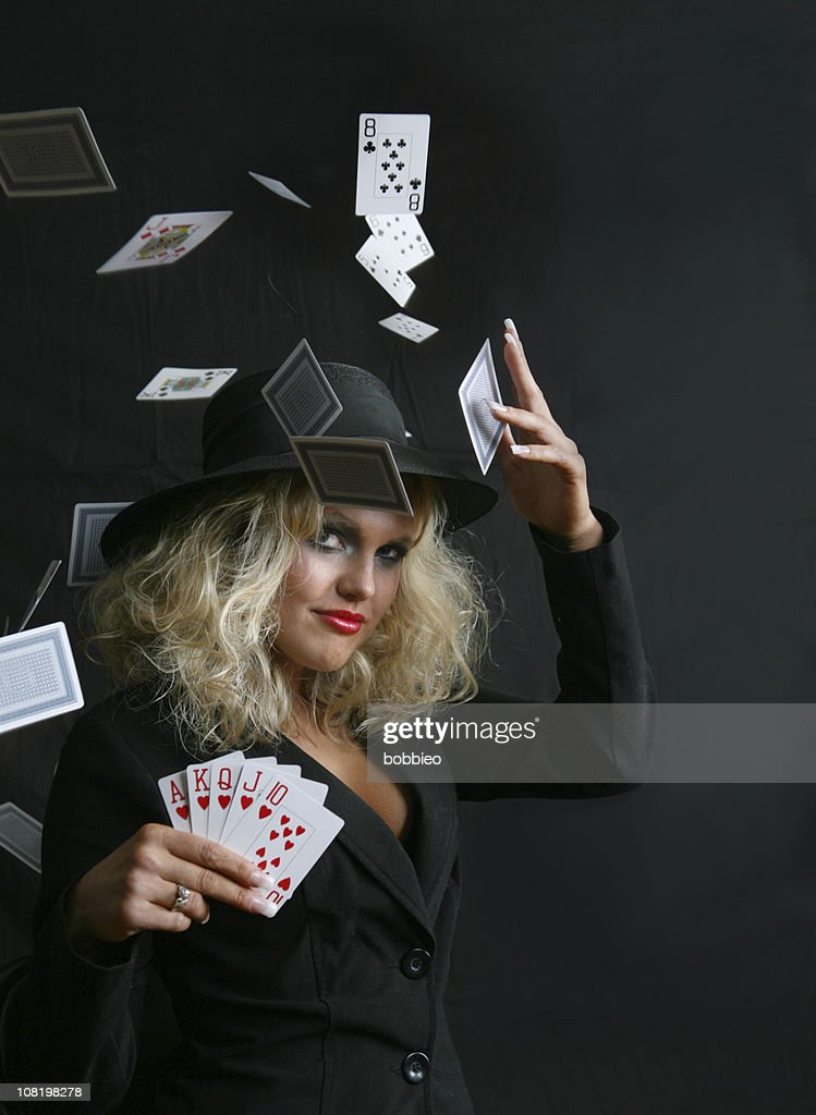 Young Woman With Royal Flush Throwing Cards in Air : Stock Photo