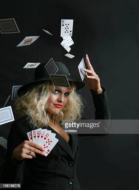 Young Woman With Royal Flush Throwing Cards in Air