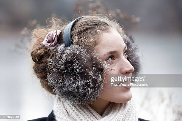 Young woman with scarf and earmuffs