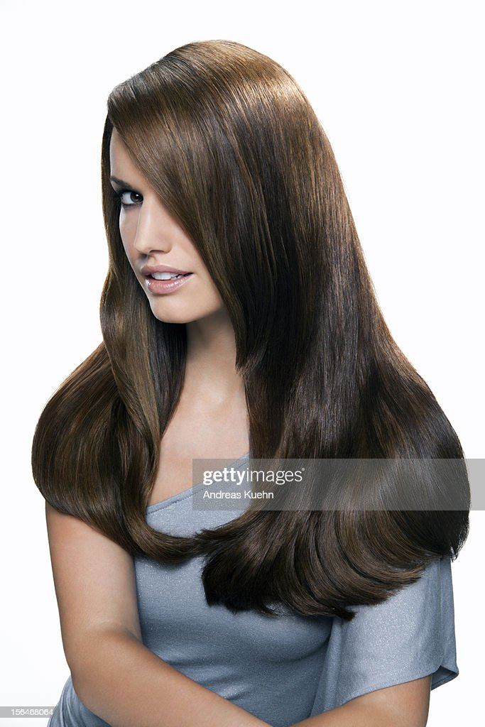 Young woman with shiny brown hair. : Stock Photo