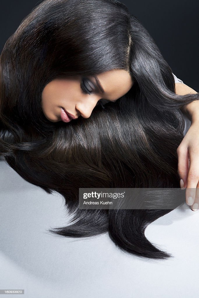 Young woman with shiny hair laying down her head. : Stock Photo