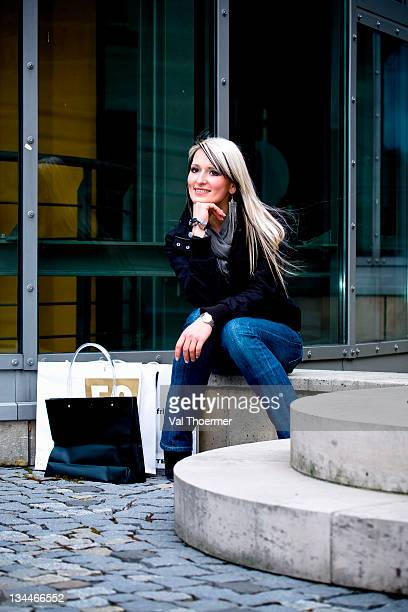 Young woman with shopping bags in an urban environment