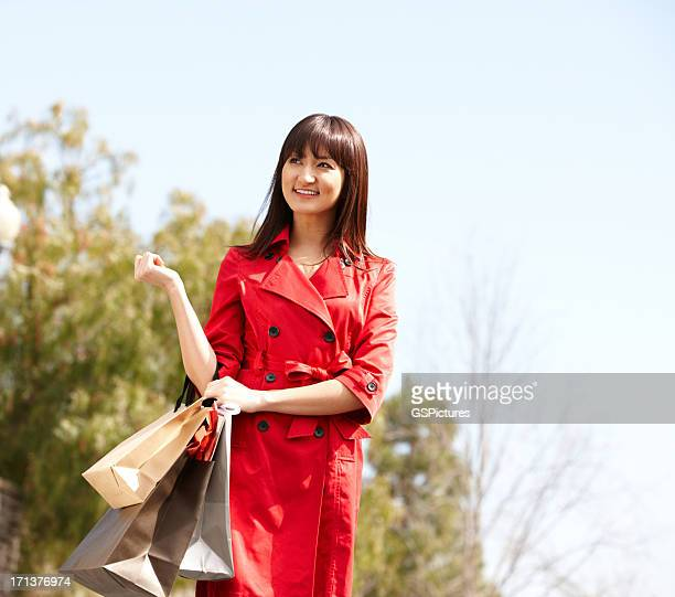 Young woman with shopping bags outdoors