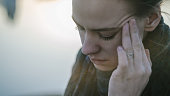 Young woman with sinus pressure pain. Depressing state concept