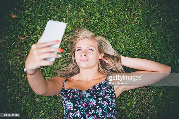 young woman with smart phone in summer