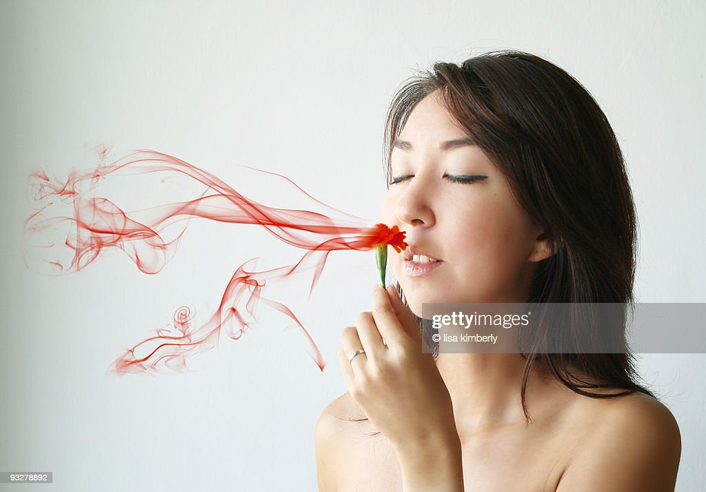 Young Woman with Smoky Red Flower : Stock Photo