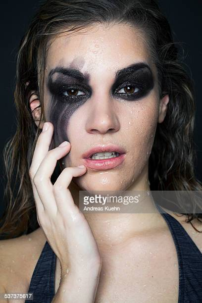 Young woman with smudged make up, portrait.