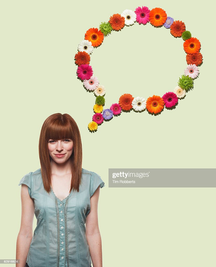 Young woman with speech bubble made of flowers : Stock Photo