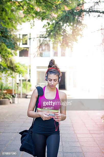 Young woman with sport bag