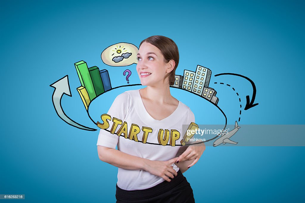 Young woman with startup sketch : Stock Photo