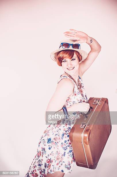 Young woman with suitcase in retro style