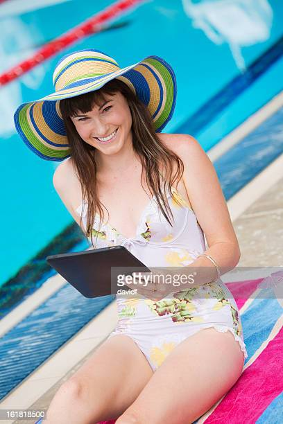 Young Woman WIth Tablet Computer By the Pool