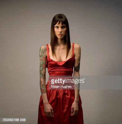 Young woman with tattoo, portrait, close-up : Stock Photo