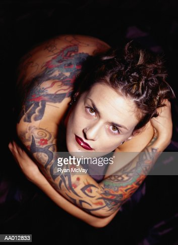 Young woman with tattoos, portrait, overhead view : ストックフォト