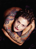 Young woman with tattoos, portrait, overhead view