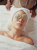 Young woman with teabag on eyes in beauty parlour, elevated view