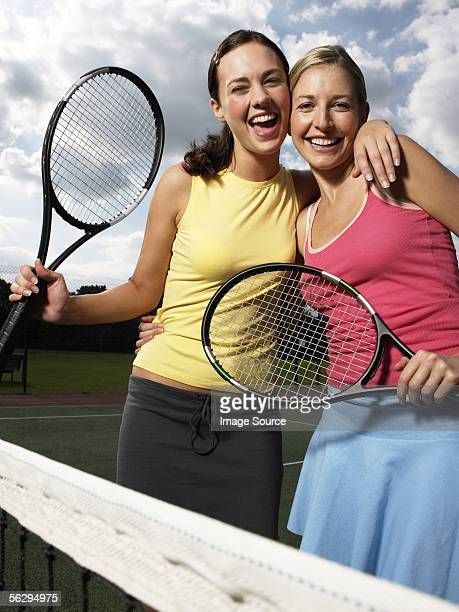 Young woman with tennis rackets