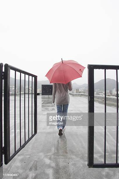 Young woman with umbrella