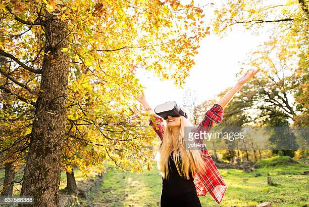 Young woman with Vr headset in park