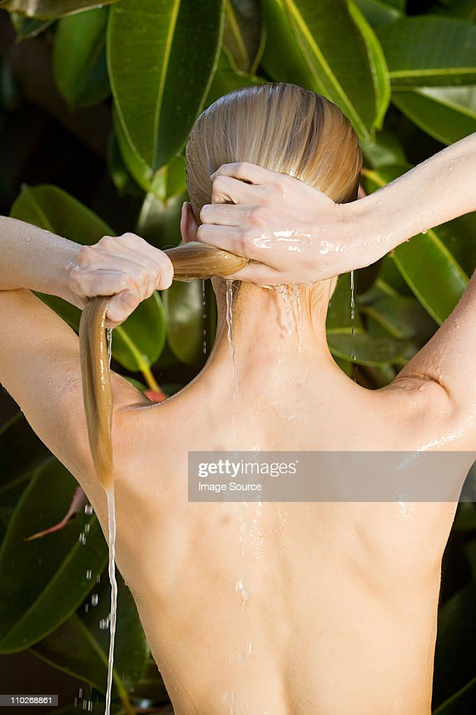 Young woman with wet hair : Stock Photo