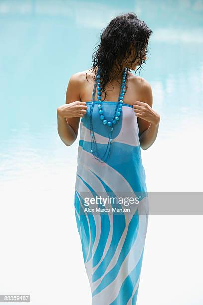 young woman with wet hair, poolside