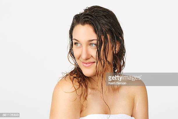 Young woman with wet hair wearing towel