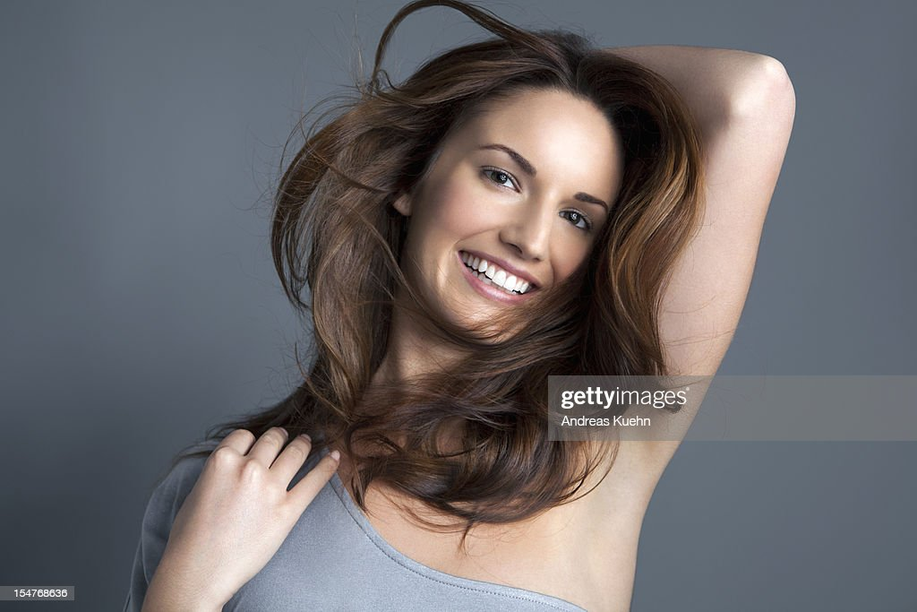 Young woman with wind blown brown hair, portrait. : Stock Photo