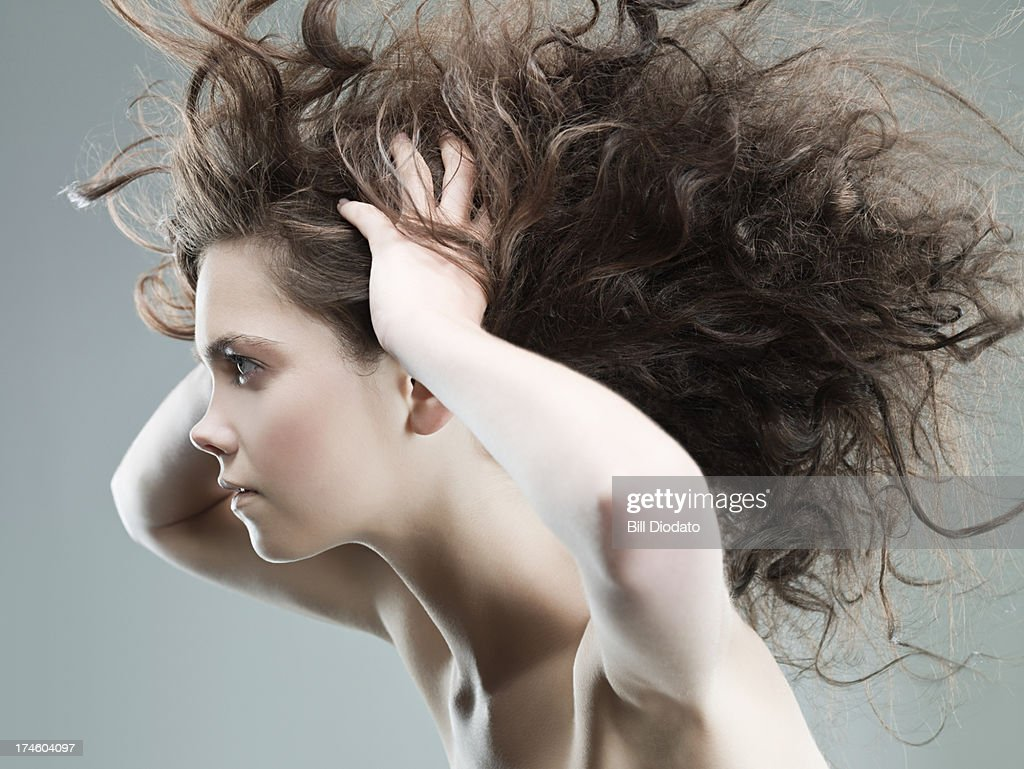Young woman with with wild hair : Stock Photo